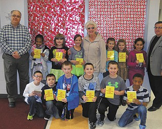 SPECIAL TO THE VINDICATOR Struthers Rotary is continuing its participation in the Dictionary Project, which assists students in becoming good writers, active readers, creative thinkers and resourceful learners. Educators believe third grade is the dividing line between learning to read and reading to learn. Struthers Rotary provides dictionaries to all third-grade students at Campbell, Lowellville, Struthers and St. Nicholas schools. From left are Rotarians Tom Baringer, Mary Ann Morell and Anthony Quahliero with third-graders from Struthers.