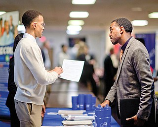 Retired U.S. Air Force Master Sgt. Thomas Gipson of Atlanta, right, has his resume looked over by Ralph Brown, a management and program analyst with the Centers for Disease Control and Prevention, during a job fair for veterans at VFW Post 2681in Marietta, Ga. The number of people seeking U.S. unemployment benefits rose 68,000 last week to a seasonally adjusted 368,000, the largest increase in more than a year.