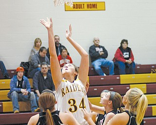 South Range's Sara Durr (34) goes up for a basket during Monday's victory over Mineral Ridge at South Range High School. South Range won, 70-23.