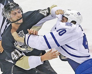 Penguins defenseman Robert Bortuzzo (41) and Maple Leafs forward Troy Bodie (40) fight in the first period of Monday's game at Consol Energy Center in Pittsburgh. The Pens won, 3-1.