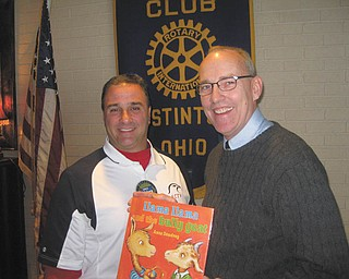 SPECIAL TO THE VINDICATOR:  Don Terpak, right, of Zapadap Apps, recently explained the rapid growth of mobile marketing and applications on smart phones to members of the Rotary Club of Austintown. Vince Colaluca, Rotary president, honored Terpak by presenting him with a book, which will be placed in the Austintown Elementary School library.