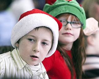 William D Lewis The Vindicator Tegan Looymans(correct), 1rst grade and Emily Chambers, 2nd grade, try to get a glimpse of Santa during Struthers Rotary Christmas party 12-17-13 at Struthes Presbyterian Church.They are students at Austintown elem School.