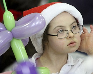 William D Lewis The Vindicator MaryKay Spitler, 7, (correct) dons festive attire during Struthers Rotary Christmas party 12-17-13 at Struthers Presbyterian Church. She is a student at Campbell elem School.