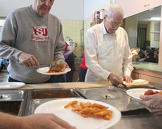 William D Lewis The Vindicator Volunteers Jim Watt, left, and Bill Liggett , both members of Struthers  Presbyterian Church serve up lunch during Struthers Rotary Christmas party 12-17-13 at Struthers Presbyterian Church.