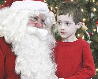 William D Lewis The Vindicator Zachary Stillerman, kindergarten student from Canfield talks to Santa during Struthers Rotary Christmas party 12-17-13 at Struthers Presbyterian Church.
