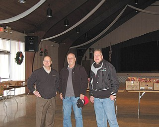 SPECIAL TO THE VINDICATOR:  The Kiwanis Club of Western Mahoning County distributed 68 food baskets to needy families Nov. 26. Some members who participated are, from left, Rob Gardner, Tom Eisenbraun and Don Augenstein. The club also is sponsoring three free photo opportunities with Santa at Farmers National Bank, 20 S. Broad St., Canfield. Parents can take children Saturday. Photo sessions will be from 9 a.m. to noon and will be available on a first-come, first-served basis.