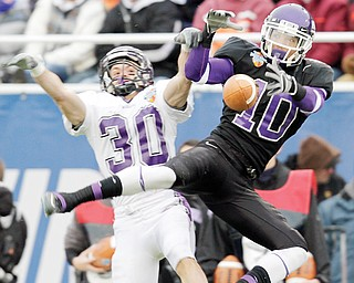 Wisconsin-Whitewater defender Ronnie Blaszkowski (30) breaks up a pass intended for Mount Union wide receiver and Cecil Shorts III during the 38th Amos Alonzo Stagg Bowl. The two teams will face off for the eighth time for the Division III Championship tonight.
