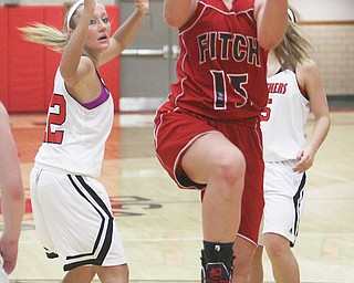 Fitch's Cassie Custer goes in for a layup past Halle Smrek (32) of Struthers during the second quarter of their game Thursday in Struthers. The Falcons downed the Wildcats, 54-45.