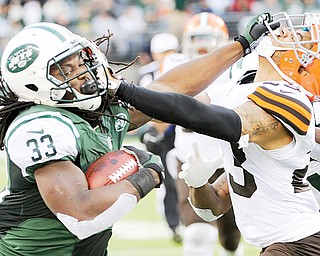 Jets running back Chris Ivory stiff -arms the Browns' Joe Haden during the second half of their NFL game in East Rutherford, N.J. Cleveland coughed up a 10-0 lead to fall 24-13 to New York.