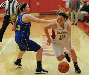 Columbiana #24 Emily Witmer dribbles around Southern defender #12 Abby Smalley on her way to the basket during the 1st half of Monday nights game.