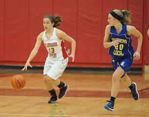 Columbiana #13 Mariah Rovnak dribbles the ball up court away from Southern defender #20 Natalie Utt during the 1st half of Monday nights game.