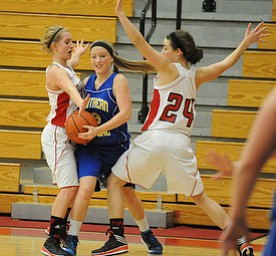 Southern #3 Mickenzie Mouts attempts to escape from the Columbiana #24 Emily Witmer and #5 Baylie Mook during the 2nd half of Monday nights game.