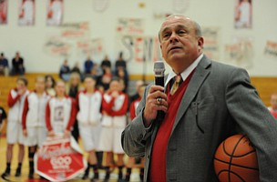 Columbiana head coach Ron Moschella speaks over the PA system while holding the game ball after his 600th career win Monday night.