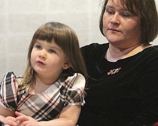 William D Lewis The Vindicator Stephanie Kopey and her daughter Lydia Kopey, 3, during Christmas Eve service at Western Reserve United Methodist Church in Canfield. They are from Howland.