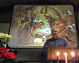 William D Lewis The VindicatorPastor Rev Russ Adams delivers sermon during Christmas Eve service at Western Reserve United Methodist Church in Canfield.