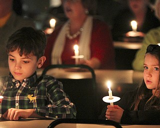 William D Lewis The Vindicator Sebastian Timko, 9, and his sister Kendall Timko, 5, hold candles and sing Silent Night during Christmas Eve service at Western Reserve United Methodist Church in Canfield. They are children of Justin and Valerie Timko of Boardman.
