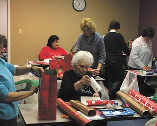 SPECIAL TO THE VINDICATOR Home Instead Senior Care, 45 N. Canfield Niles Road 600, Austintown, hosted a gift-wrapping party Dec. 16 for the annual Be a Santa to a Senior holiday project. Several volunteered to wrap the gifts. Participating local nonprofit organizations identify the needy seniors in the community and provide those names to Home Instead Senior Care for this community service program.