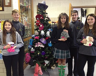 SPECIAL TO THE VINDICATOR The National Junior Beta Club members at Holy Family School in Poland collected hats and mittens to contribute to those in need. Students hung them on a Christmas tree in the lobby of the school. Beta Club members, from left, are Marisa Ricciardi, Luke Stoeber, Katrina Hayes, Anthony Fire and Kristen Eckman.