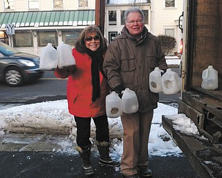 SPECIAL TO THE VINDICATOR The Poland Rotary and friends recently helped set up more than 400 luminaries lining Route 170 from the Township Hall to Peterson Park. The club also sponsored carriage rides. Mary Ann Carano, left, and Larry Warren helped clean up after the festivities.