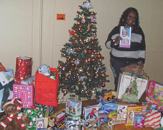 SPECIAL TO THE VINDICATOR The Wish Upon A Star gift-giving project, operated by the YWCA of Youngstown, has a goal to put smiles on the faces of homeless and low-income children that the Y programs serve. Individuals and community groups team up with the Y to gather new toys, books, games and clothing for distribution to children in need. Eighty-nine children in the YWCA Housing Program received gifts. Above, Vicki Winphrie, YWCA housing case manager and Wish program coordinator, appears thrilled at the sight of all the gifts that were collected.