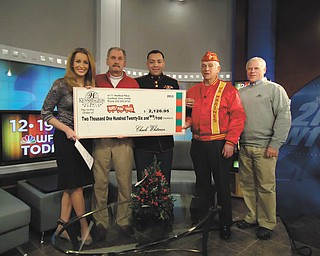"""SPECIAL TO THE VINDICATOR Canfield's Kennsington Golf Club donated more than $2,000 to local Toys for Tots when it presented a check recently on the """"WFMJ Today!"""" show with Lauren Lindvig, left. Next in line is Paul Otto, Kennsington golf pro; Marine Sgt. Modesto Montano, coordinator for the Mahoning-Trumbull Toys for Tots campaign; Harry Damph, a retired Marine; and Kennsington owner Chuck Whitman."""