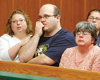 Shawn Tedesco, Teddy Foltz's biological father, center, attends the arraignment of Zaryl Bush.
