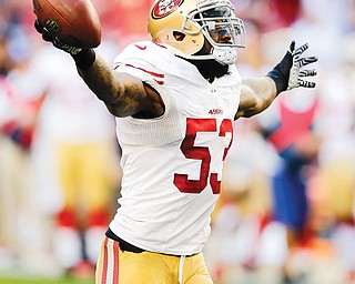 San Francisco inside linebacker NaVorro Bowman celebrates a fumble recovery against Arizona during a game in Glendale, Ariz. Bowman leads the defense for the 49ers (12-4), who open the playoffs with an NFC wild-card matchup at Green Bay on Sunday.