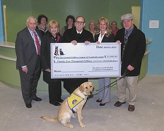 SPECIAL TO THE VINDICATOR:  The Morris and Phyllis Friedman Foundation donated $25,000 to the Animal Welfare League of Trumbull County in October. It was presented by Steve Friedman. In front, from left, are Ned Gold, Ali Patterson, Steven Friedman, Caryn Covelli and Dr. John Owen; in back are Barbara Busko, Mary Busko, Margie McCummins and Ellen Parker.