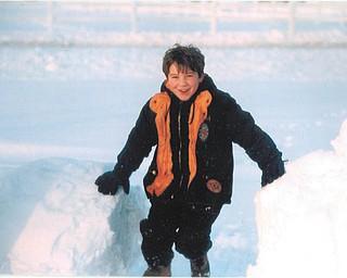 Aaron Hartsough of Canfield took pleasure in swinging on snowballs. Taken by Lana Vanauker.