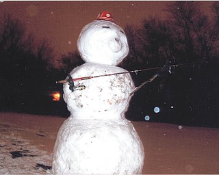 Robert Naples made a fishing snowman before Christmas. Submitted by his father, Tony Naples.