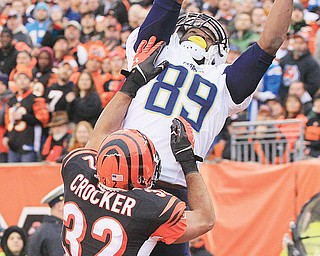 Chargers tight end Ladarius Green (89) catches a 4-yard touchdown pass against Bengals safety Chris Crocker (32) in the second half of Sunday's AFC wild-card playoff game in Cincinnati.