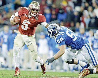 Florida State's Jameis Winston (5) scrambles as Duke's Kelby Brown (59) defends in the first half of the Atlantic Coast Conference Championship in Charlotte, N.C.