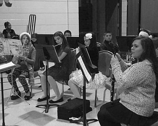SPECIAL TO THE VINDICATOR St. Patrick School in Hubbard had its annual Christmas program and band concert for family and friends over the recent holiday season. Members of the school band in grades four through eight provided the sounds of the season, accompanying their classmates as they presented a nativity play and as each grade sang traditional carols and holiday songs. Some of the participants, from left to right, front, were Elizabeth Chrobak, Giavanna Hosack, Daniella Hosack and Camryn Ealy; and in back, Nate Wirtz and Robert Mild.