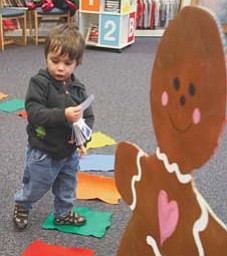 Ashton Williams, 2, of Poland ponders his next move while playing Candy Land recently at the library in Liberty.
