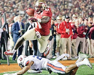 Florida State's Chad Abram leaps over Auburn's Ryan Smith for a touchdown during the second half of the BCS National Championship game Monday in Pasadena, Calif.