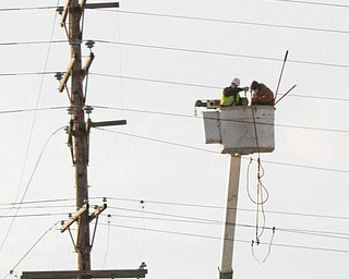 Ohio Edison battled low temps hovering around zero. strong winds and birds as they replaced a transmission line near 711 and MLK Boulevard near Brier Hill. late Tuesday afternoon.