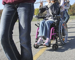 William D Lewis The Vindicator  Kaitlin Windt at Boardman HS 10-30-13. She is in a wheelchair and performs with the Boardman Marching band. Attendent Audrey Allen helps with her wheel chair.