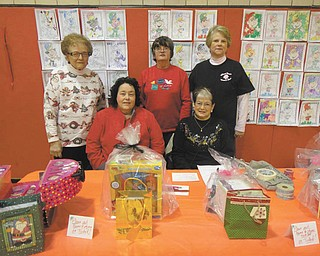 SPECIAL TO THE VINDICATOR Girard Junior Women, seated from left, are Sue Ellen Harris and Collete Chuey; and standing are Marilyn Kobal, Roberta Lawrentz and Kathy Rossell, some of the volunteers for the annual bazaar in December. All proceeds are donated to the Girard community. Their next fundraiser will be a trunk and treasure sale in May. For information about this fundraiser or membership call 330-545-5962.