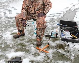 Bob Edwards of Minerva chose to go ice fishing at Berlin Lake.