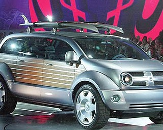 The Dodge Kahuna concept vehicle is unveiled at the North American International Auto Show in Detroit. Aimed at surfers, the Kahuna was a cross between a Woodie wagon and a minivan.