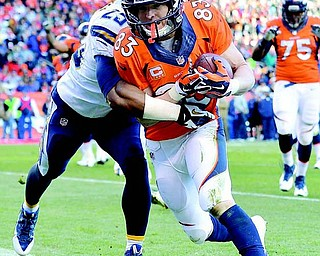 Broncos WR Wes Welker crosses the goal line after a nine-yard touchdown catch against Chargers DB Darrell Stuckey in the second quarter of Sunday's AFC division playoff in Denver. The Broncos held off the Chargers to win 24-17 and advance to the AFC championship against the New England Patriots.