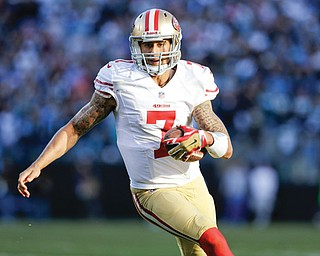 San Francisco 49ers quarterback Colin Kaepernick carries the ball against the Carolina Panthers during the second half of an NFC divisional playoff game Sunday in Charlotte, N.C.