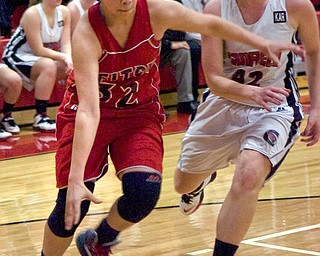 Austintown Fitch guard Allexis Sallee drives toward the basket Monday night against Canfield defender Erin Risner at Canfield High School.