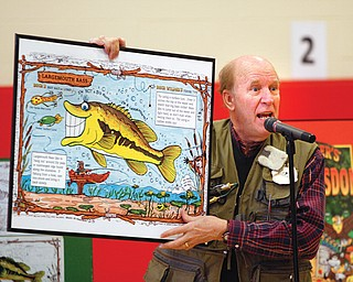 Buck Wilder, also known as Tim Smith, tells about his style of writing and hiding objects in every page of his books. Smith visited Austintown Intermediate School on Tuesday to get the students excited about reading  nonfiction.