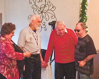 Members of the club presented a check to a sight-impaired member. They raised more than $3,000 last year to buy him specialized equipment, and the check was for the balance in the fund after the purchase. From left to right are Stein, Haren, Ted Filmer and Mike Austin.
