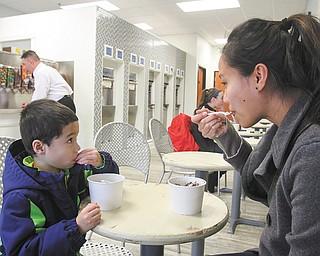 Tiffany Polish and her son, Logan, 4, enjoy a treat at Naticakes.