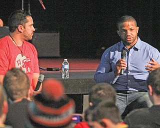 Former Warren Harding and Ohio State football standout Maurice Clarett, right, addresses the audience during a speaking engagement Wednesday at The Riot youth center of Victory Assembly of God in Coitsville. Over 150 youths from northeastern Ohio and western Pennsylvania attended the event, which was sponsored by Victory Revolution Youth Ministry, which is headed by Pastor Nate Ortiz, left, a friend of Clarett.