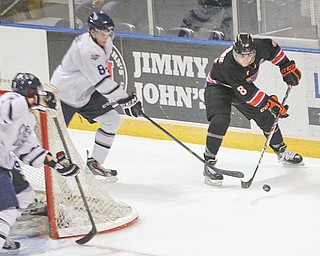 """The Youngstown Phantoms' Josh Melnick moves the puck from behind the net against Indiana Ice defender Joshua Jacobs during the annual """"School Day Game"""" Wednesday at the Covelli Centre in Younstown. The Phantoms fell 7-4. It was the sixth time the two teams have faced one another and the fifth win for the Ice, who are in first place in Eastern Conference standings."""