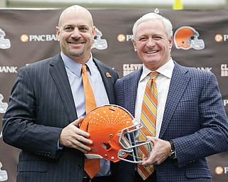 The Cleveland Browns new head coach Mike Pettine, left, poses with owner Jimmy Haslam after being introduced to the media Thursday in Berea. The former Buffalo defensive coordinator met with team officials three times in the last week before finalizing a contract Thursday. He is the Browns' seventh full-time coach since 1999.