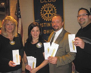SPECIAL TO THE VINDICATOR Austintown Rotary met recently to plan its annual reverse raffle scheduled for March 8 at the Maronite Center. Raffle leaders, from left, are Tracy Kaglic, chairwoman of the basket auction; Deanna Spirko, chairwoman of tickets; Mark Cole, president; and Mike Cafaro, chairman of the committee.